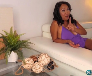 Mandy Thai is a voluptuous, mature brunette who loves to get cum all over her face