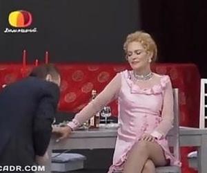 Russian mature moviestar Alena Yakovleva in stockings flashing black panties